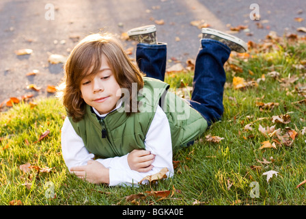 boy lying on stomach - Stock Photo