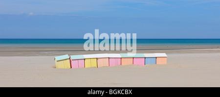 Row of colourful beach cabins in pastel colours along the North Sea at Berck, Côte d'Opale, Pas-de-Calais, France - Stock Photo