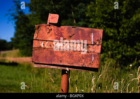 Old rusty mailbox in Prince Edward Island, Canada - Stock Photo