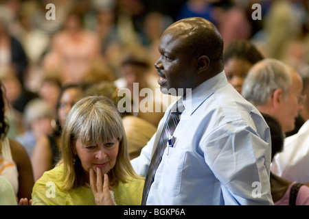 Ugandan minister prays for healing at rally organised by Cor Lumen Christi Community London uk - Stock Photo
