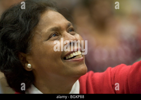 Woman gives thanks to God at rally organised by Cor Lumen Christi Community London uk - Stock Photo