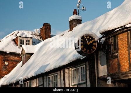 The snow covered Church Loft Clock on West Wycombe High Street. The clock dates for C1670. Buckinghamshire, England, - Stock Photo