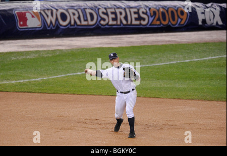 Alex Rodriguez #13 of the New York Yankees throws over to first base against the Philadelphia Phillies in Game One - Stock Photo