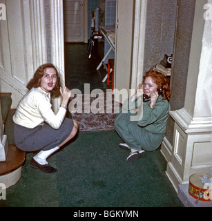 NEW JERSEY, U.S.A. - Teenage Girls on Telephone at Home, in the 1950's., Family Photo Archives - Stock Photo