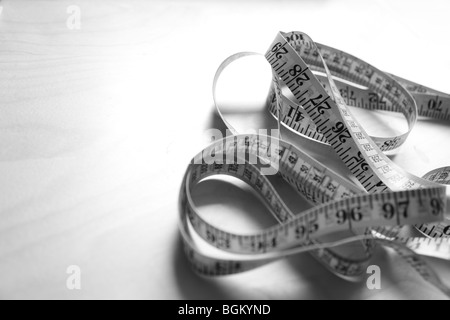 Close up of tape measure in black and white - Stock Photo