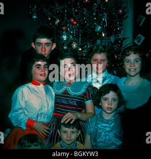 1950's Family Photo, 7 Children Posing for Portrait on Christmas Day at Home in Living Room. 'Old Family Photos' - Stock Photo