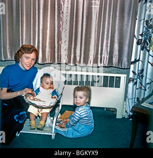 USA - Family at Home, Baby boy, with sisters.'Old Family Photos'. - Stock Photo