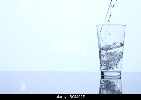 Pouring glass of water - Stock Photo
