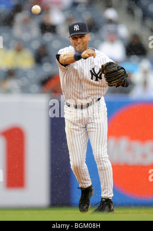 Derek Jeter #2 of the New York Yankees throws to first against the Oakland Athletics on April 22, 2009 at Yankee - Stock Photo