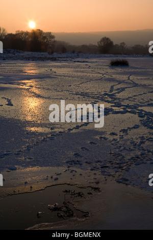 Winter scene, Iskar dam frozen, animal footprints on the ice - Stock Photo