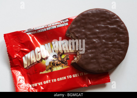 Wagon Wheels biscuit - individual packet of original flavoured Wagon Wheels biscuits set on white background - you've - Stock Photo