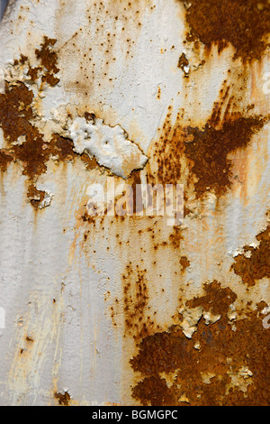 Paint peeling on rusty old wall - Stock Photo