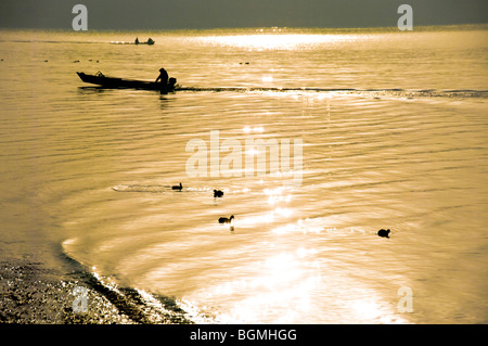 Boat and birds on the sparkling sea. Oarai, Oarai-machi, Ibaraki Prefecture, Japan - Stock Photo