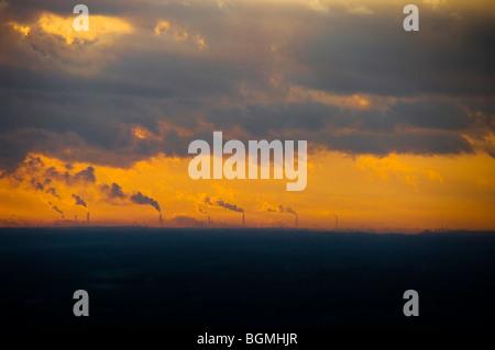Sunrise over smoke stacks emitting smoke, Atago-yama, Kasama, Ibaraki Prefecture, Japan - Stock Photo