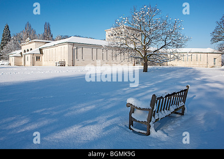Air Forces Memorial Runnymede - Portico & East Wing / Lookout with Snow Laden Tree & Bench in Foreground - Stock Photo