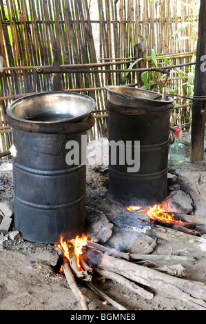 Laos; Bokeo province; Cottage Distillery for making Lao Lao Rice Whisky in a village near Huay Xai - Stock Photo