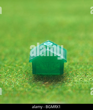small green house on grass - Stock Photo