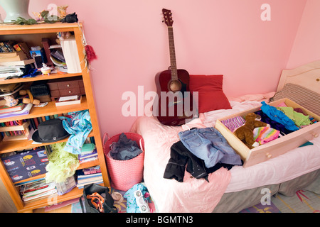 A female teenager's messy bedroom. - Stock Photo