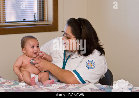 Student nurse at Native American college examines baby with stethoscope