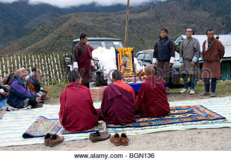 Monks Blessing A Newly Received Car In a Rural Mountainous Village In Bhutan - Stock Photo