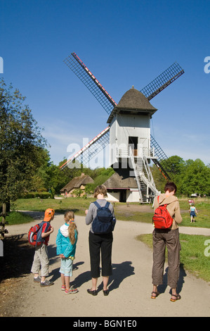 Tourists in front of windmill in the open air museum Bokrijk, Belgium - Stock Photo