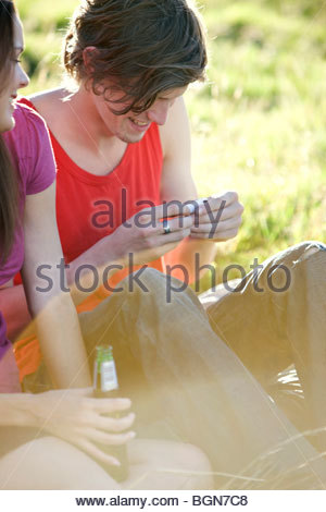 A young man rolling a cigarette - Stock Photo
