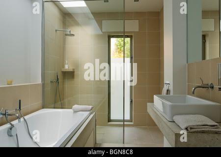 Ground floor bathroom with skylight and Philippe Starck sanitaryware - Stock Photo