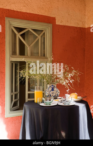 Breakfast table in a riad in the Medina of Marrakesh - Stock Photo