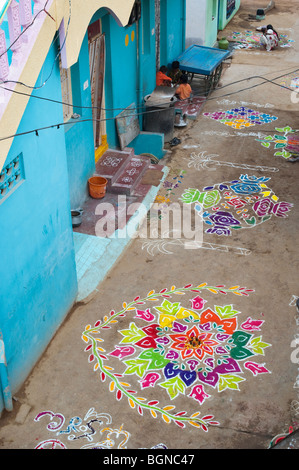 Rangoli designs in an Indian street , during the hindu festival of Sankranthi. Puttaparthi, Andhra Pradesh, India - Stock Photo
