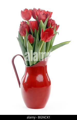Red tulips in enamel jug - Stock Photo