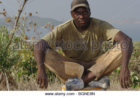 Izza, a 31 year old migrant worker from Senegal, Africa poses in Greece - asylum seekers - Stock Photo