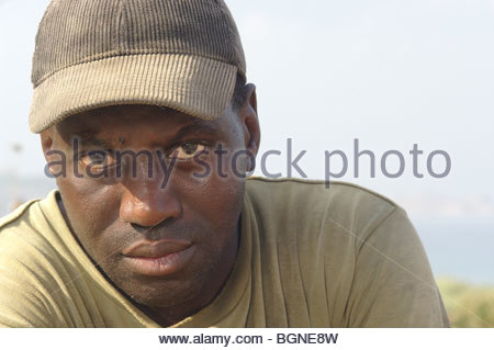 Izza, a 31 year old migrant worker from Senegal, Africa poses in Greece. - Stock Photo
