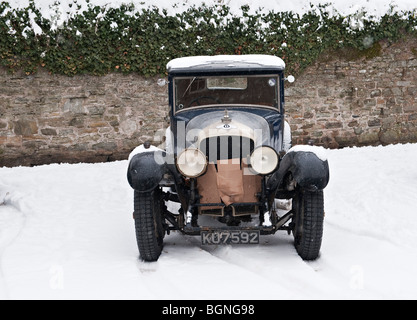 A vintage Bentley parked in the snow, its radiator protected against the cold - Stock Photo