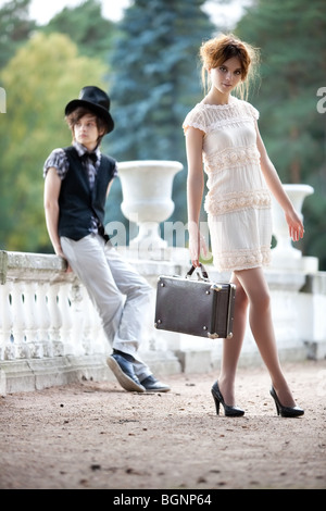Young couple fashion. Young walking lady and gentleman. - Stock Photo