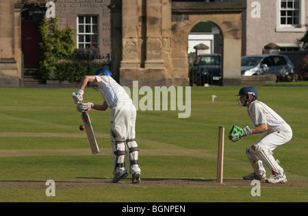 An Under-15s Scottish cricket match in Kelso, Scottish Borders, held in a public park - Stock Photo