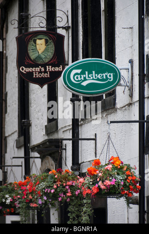 Old and new signs - in style - on a Scottish pub, the Queen's Head in Kelso - Stock Photo