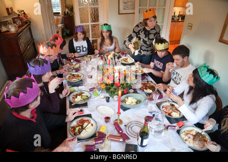 family and friends at a christmas dinner party on xmas day in the