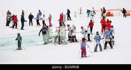 Young children skiing on nursery slopes in Ski School, Avoriaz, Morzine, French Alps, France - Stock Photo