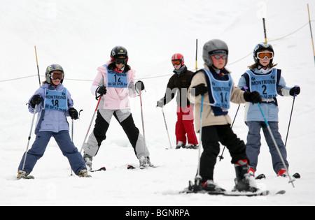 Younger children on the nursery slopes in Ski School, Avoriaz, Morzine, French Alps, France - Stock Photo