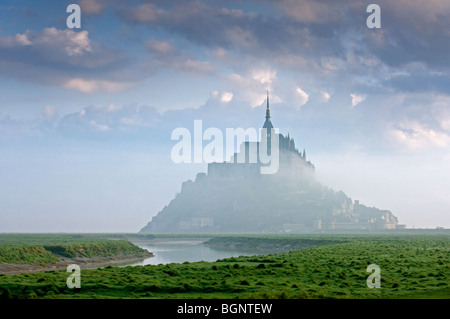 The Mont Saint-Michel / Saint Michael's Mount abbey in the fog, Normandy, France - Stock Photo
