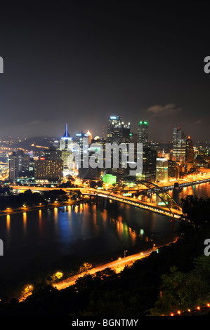 Pittsburgh skyline at night in vertical format - Stock Photo