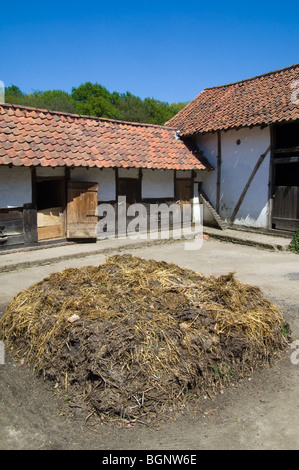 Dunghill / dungheap with manure at the inner courtyard of traditional farm in the open air museum Bokrijk, Belgium - Stock Photo