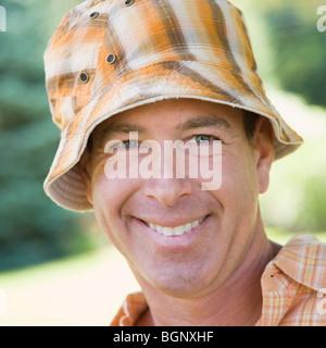 Portrait of a mature man smiling - Stock Photo