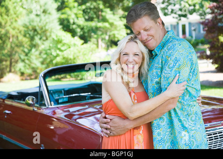 Mature couple embracing each other - Stock Photo