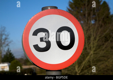 Thirty mile speed limit road sign 30 mph - Stock Photo