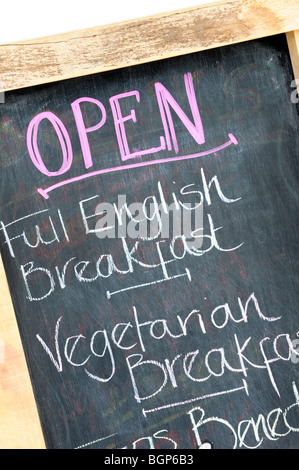 A cafe pavement sign offering Full English breakfast on the menu. - Stock Photo