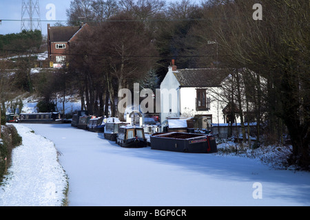 Staffordshire and Worcestershire Canal at Hinksford covered in ice and snow - Stock Photo