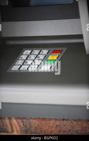 A hole in the wall ATM cash dispenser keyboard. - Stock Photo