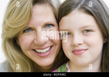 Portrait of a mature woman smiling with her daughter - Stock Photo