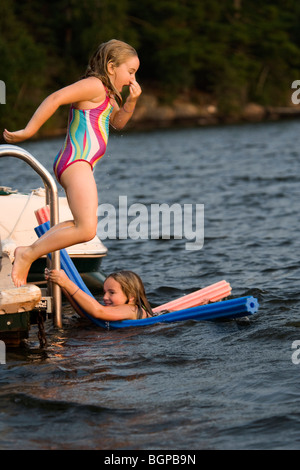 Young girls playing in lake, Lake of the Woods, Ontario, Canada - Stock Photo